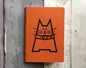 Handmade notebook - blank orange pocket notebook featuring Dave the cat - hand-printed, hand stitched