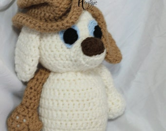 Crochet Floppy Puppy by The Handmade Heritage in cream and tan with possible accessories and lots of snuggly soft and fun personality!