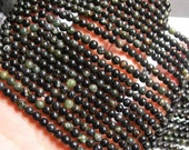 Astrophyllite -   4mm  round - A quality - 99 beads per strand -  1 full strand - very rare - RFG599