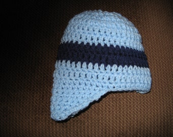 light blue hand made crochet hat with navy stripe