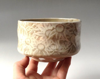 Deep bowl in white and buff glaze with Australian Flannel Flower design