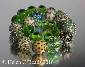 Large statement necklace in ivory and green with handmade lampwork beads by Helen Gorick