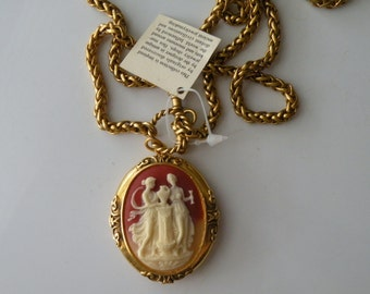 Cameo locket pendant necklace. Gold plated chain