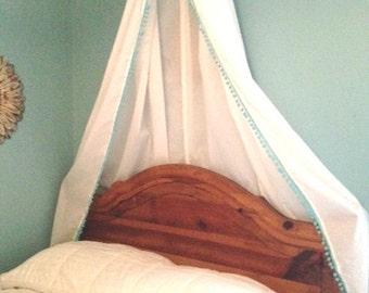 White canopy with Blue Pom Pom trim