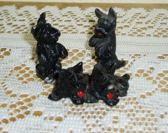 Four Little Black Cast Metal Scottie Dogs