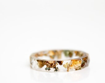 size 9.5 resin ring - transparent eco resin with variegated metallic flakes