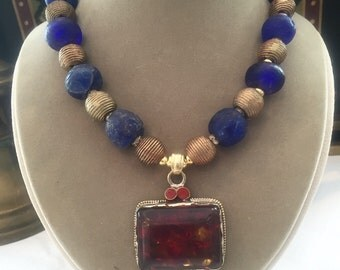 Trade beads Tibetan amber pendant and African brass beads necklace
