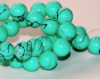 13 pcs 10mm Opaque Pale Blue Green with Black Accents Round Glass Beads