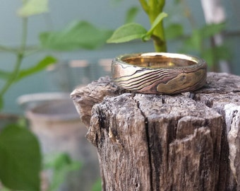 Rustic wood grain ring mokume gane red gold and yellow gold with etched sterling