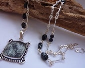 Necklace: long hand forged beaded chain with tourmalated quartz pendant set in sterling silver - monochrome