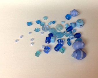 51 Blue Beads plus a bag of micro beads ... destash sale ...  different shades of Blue, shapes and sizes vary  ...  Beads As Shown