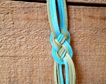 Faux suede chinese knot bracelet in green, blue, and gold.