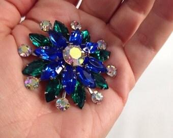 vintage rhinestone brooch. Blue Green AB Sparkly Prong Set Flower Snowflake Pin