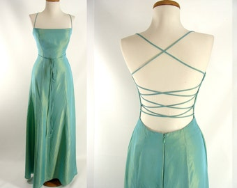 As-Is. Iridescent Green Dress. Open Back Gown. Criss Cross Strap. Fancy Dress. or Customizable Zombie Costume. OPTIONAL BLOOD size 2 4 XS S
