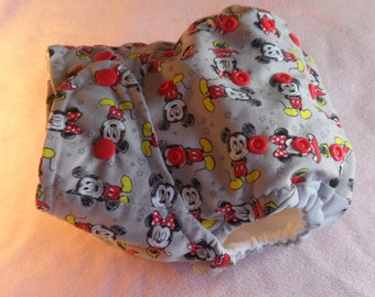 SassyCloth one size pocket diaper with Mickey and Minnie cotton print. Made to order.