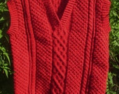 Boy's childs toddlers handknit red aran cable sleeveless vee neck sweater.