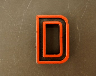 "Vintage Industrial Letter ""D"" Black with Orange and Blue Paint, 2"" tall (c.1940s) - Monogram Display, Shadow Box Letter, Art Supply"