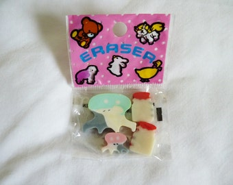 Vintage novelty cow and milk bottle erasers still in orginal packet made by prince