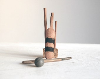 small toy hand carved wooden cricket set