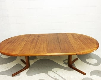 mid century modern teak table by Dyrlund made in denmark dining table with two leaves