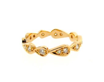 yellow gold diamond chasing droplets stackable wedding band