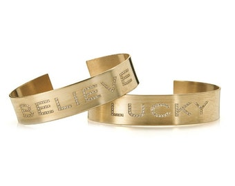 Cuff bracelet. personal engraving. available in gildfilled/silver. set with zirkons.
