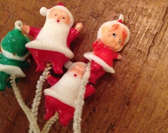 Small plastic santa and elves Christmas Ornament pipe cleaner tie on