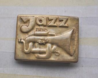 Vintage brass belt buckle.Jazz.