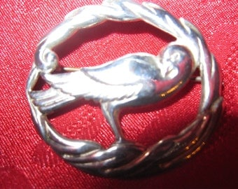 Sweet sterling pin of a bird on an oval branch