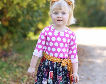 Girls knit bodice dress with sash.  Available in sizes 6 months to 12 years.