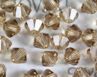 144 pieces Genuine Swarovski Crystal 5328 5301 2.5mm Xilion Bicone Beads Light Colorado Topaz