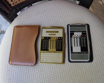 Vintage Addiator Duplex  - & Addimult Sumax-6 Mechanical hand calculators in cases with metal wands 1950s