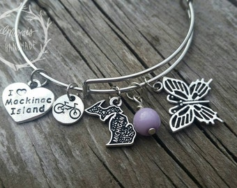 Mackinac Island bracelet - charm bangle bracelet with butterfly, ceramic lilac bead, bike and Mackinac Island charms - gift for her