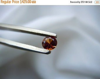 SEPTEMBER SALLE Gorgeous Montana Sapphire Vibrant Orange Round Brilliant .31 carat Loose Gemstone