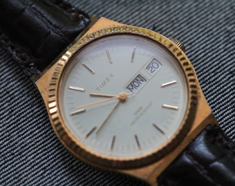 Vintage Timex Automatic watch with gold tone case and fluted bezel