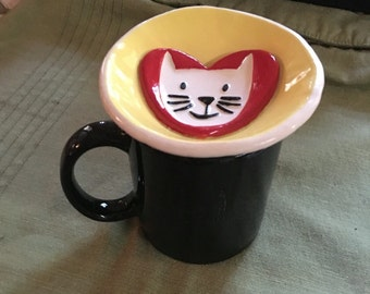 Kitty stay out of my glass! This Stoneware dish rests on beverage glass so sneaky pets can't sip too. Ek Creations Design.