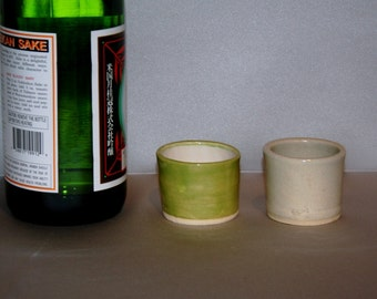 Two Sake cups in stoneware. Made with a variety of cone 5 glazes. Enjoy your sake in style. Pick a pair to share.