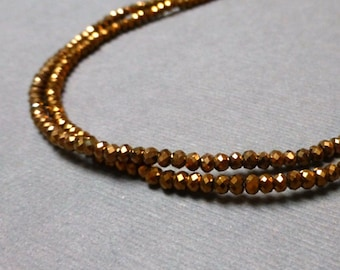 Sparkly Glass Rondelles. Faceted Rondelles. Copper Metallic. 1.5mm-2mm. Full Strand. One (1).