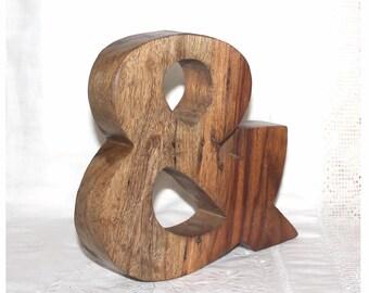 Large chunky wood  ampersand. Sans serif