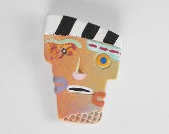 Unique, primative looking clay brooch, 3 faces in one