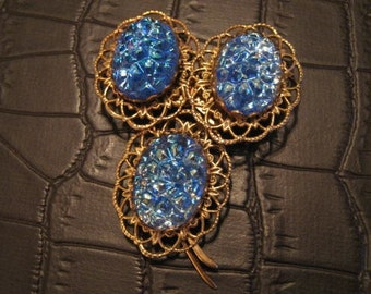 Vintage blue filigree plastic brooch.