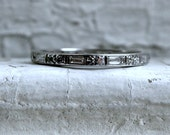 Fantastic Vintage Platinum Eternity Wedding Band with Baguette and Round Cut Diamonds.