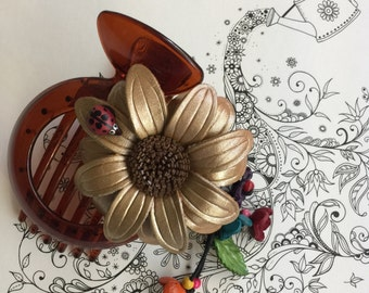 Sunflower Leather flower with lady bug