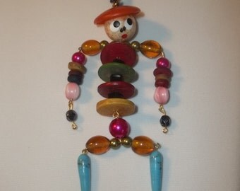 Vintage articulated handpainted man w/hat pendant/necklace bakelite/plastic/wood/lucite/pearls one of a kind!