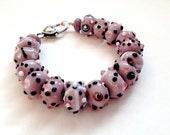 Purple bracelet. Big purple bead lampwork bracelet. Dot bracelet. Purple Lampwork glassbead bracelet dots. Purple and black. Linnepin010