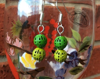 Green filigree ball dangle earrings