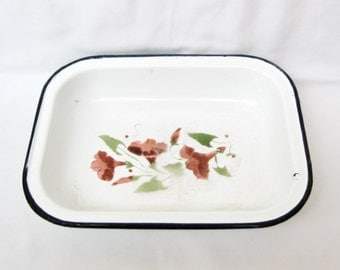 Vintage enamel baking dish. White with black edge and flower decoration 60s