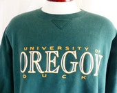 Go UO Ducks vintage 90's University of Oregon dark forest green fleece graphic sweatshirt yellow gold white logo print logo crew neck medium