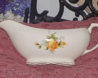 Pretty White Gravy Boat  with Yellow Roses on it.   :)S