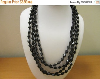 ON SALE Vintage 4 Strand Black Plastic Beaded Necklace Item K # 3179